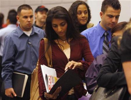 A woman waits in line to talk to job recruiters at a career fair in Los Angeles February 3, 2009. REUTERS/Lucy Nicholson