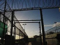 "<p>Razorwire-topped fences are seen at the ""Camp Six"" detention facility at U.S. Naval Station Guantanamo Bay December 10, 2008, in this file photo reviewed by the U.S. military. Canada could accept three Chinese Moslem Uighur men who are imprisoned at the facility in Cuba but have been cleared for release, the Globe and Mail newspaper reported on Wednesday. REUTERS/Mandel Ngan/Pool</p>"