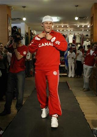 Ross Rebagliati, 1998 gold medal winner in snowboarding at the Winter Olympics in Nagano, Japan shows off the new Canadian team summer Olympic uniforms in Vancouver British Columbia May 18, 2004. REUTERS/Lyle Stafford