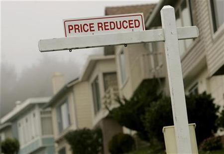 A sign advertising a home for sale at a reduced price is shown in Pacifica, California December 31, 2008. REUTERS/Robert Galbraith