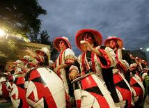 "<p>Members of a ""comparsa"", a Uruguayan carnival group, participate in the ""llamadas"" parade in Montevideo February 5, 2009. REUTERS/Andres Stapff</p>"