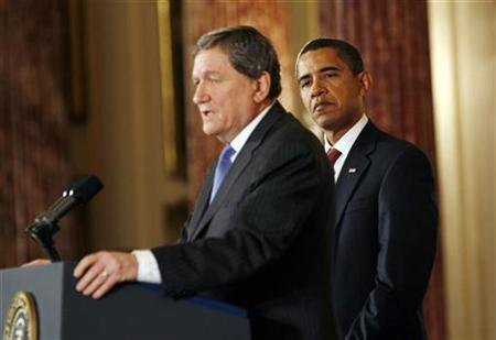 President Barack Obama listens as Richard Holbrooke, the U.S. envoy to Pakistan and Afghanistan, speaks at the State Department in Washington, January 22, 2009. REUTERS/Kevin Lamarque