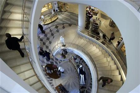 Shoppers take the stairs at Barneys New York in Las Vegas, Nevada January 18, 2008. REUTERS/Las Vegas Sun/Steve Marcus