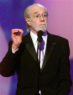 Comedian George Carlin speaks after being presented the Lifetime Achievement Award April 22, 2001 at the 15th annual American Comedy Awards in Los Angeles. REUTERS/Fred Prouser