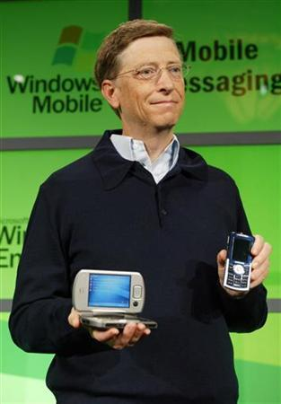 Microsoft co-founder Bill Gates holds Windows Mobile devices before his keynote address at the 2005 Microsoft Mobile and Embedded DevCon Electronics conference, in Las Vegas, May 10, 2005. REUTERS/Jeff Christensen