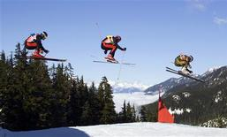<p>France's Oliver Fabre (R), Austria's Patrick Koller (C) and compatriot Wolfgang Auderer take to the air while competing in the men's ski cross at the FIS Freestyle World Cup at Cypress Mountain in West Vancouver, British Columbia in this February 6, 2009 file photo. REUTERS/Richard Lam/Files</p>