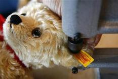 <p>A worker of German toy maker Steiff punches the Steiff brand mark, a yellow banneret, into a teddy bear's ear in the southern German town of Giengen July 7, 2008. REUTERS/Alexandra Beier</p>
