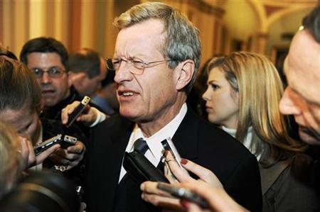 Senator Max Baucus squints as he recalls exact numbers on a compromise deal to try to pass President Barack Obama's economic stimulus package at the Capitol in Washington February 6, 2009. REUTERS/Jonathan Ernst