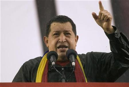 Venezuela's President Hugo Chavez speaks during a rally in Caracas, February 2, 2009. REUTERS/Carlos Garcia Rawlins