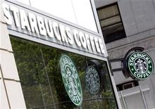<p>Starbucks signs are seen outside one of its stores in New York July 3, 2008. REUTERS/Chip East</p>