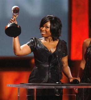 Singer Jennifer Hudson lifts her award for Outstanding New Artist at the 40th Annual NAACP Image Awards at the Shrine auditorium in Los Angeles February 12, 2009. REUTERS/Mario Anzuoni