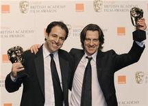 "<p>Simon Chinn and James Marsh pose with the award for outstanding British film for ""Man on Wire"" during the 2009 BAFTA (British Academy of Film and Television Arts) awards ceremony at the Royal Opera House in London February 8, 2009. REUTERS/Toby Melville</p>"