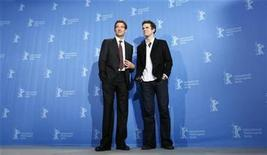 <p>German Director Tom Tykwer (R) and, British actor Clive Owen pose during a photocall to promote the movie 'The International' of the 59th Berlinale film festival in Berlin February 5, 2009. REUTERS/Johannes Eisele</p>