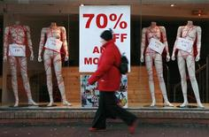 <p>A woman walks past a shop window in Limerick, southern Ireland, in this January 28, 2009 file photograph. REUTERS/Gina Brocker/Files</p>
