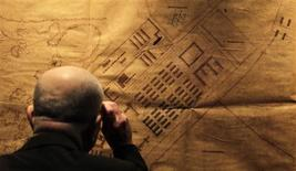 <p>People visit an exhibition featuring original architectural plans of the Nazi Auschwitz death camp in Berlin February 16, 2009. REUTERS/Hannibal Hanschke</p>