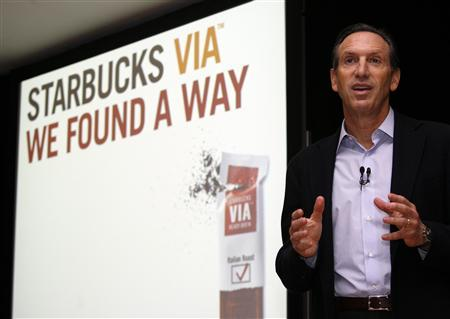 Starbucks CEO Howard Schultz holds the Starbucks VIA Ready Brew product during a news conference in New York February 17, 2009. REUTERS/Shannon Stapleton