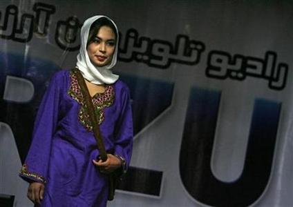 An Afghan contestant poses during a fashion competition initiated by a private television channel in the city of Mazar-I-Shariff, north of Kabul, in this file picture taken September 25, 2007. REUTERS/Ahmad Masood/Files