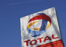 <p>A logo for oil giant Total at a petrol station in London, February 12, 2008. REUTERS/Stephen Hird</p>