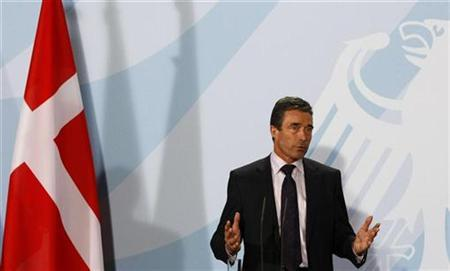 Danish Prime Minister Anders Fogh Rasmussen addresses a news conference before a dinner with German Chancellor Angela Merkel at the Chancellery in Berlin February 18, 2009. REUTERS/Fabrizio Bensch