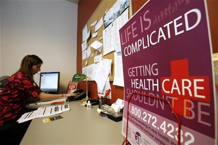 Hannah Frigand helps a caller with a health insurance question at the non-profit 'Healthcare For All' in Boston, Massachusetts in this January 19, 2007 file photo. REUTERS/Brian Snyder/Files
