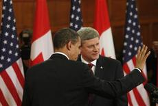 <p>President Barack Obama (L) and Prime Minister Stephen Harper leave a news conference on Parliament Hill in Ottawa, February 19, 2009. REUTERS/Jim Young</p>