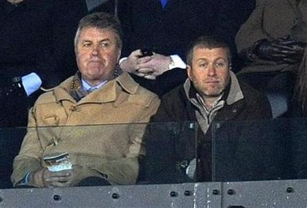 Newly appointed Chelsea manager Guus Hiddink (L) and team owner Roman Abramovich watch their team as they play Waford in their fifth round FA Cup match at Vicarage Road, Watford February 14, 2009. REUTERS/Kieran Doherty