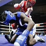 <p>Alexey Tishchenko (top) of Russia punches Daouda Sow of France during their lightweight (60kg) final boxing match at the Beijing 2008 Olympic Games, in this August 24, 2008 file photo. REUTERS/Lee Jae-Won/files</p>