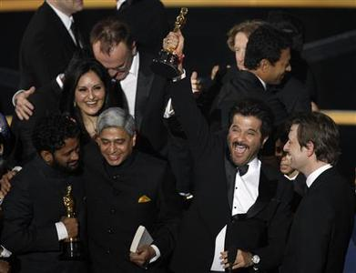 Cast members celebrate with producer Christian Colson (R) after ''Slumdog Millionaire'' won the Best Motion Picture Oscar during the 81st Academy Awards in Hollywood, California February 22, 2009. REUTERS/Gary Hershorn