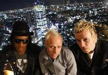 "<p>British techno group ""The Prodigy"" Maxim (L), Keith Flint (C) and Liam Howlett pose in front of a night view of Tokyo's Roppongi district after their interview with Reuters in Tokyo February 6, 2009. REUTERS/Toru Hanai</p>"