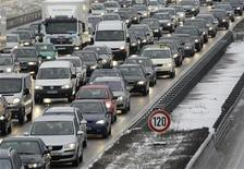 <p>Cars and trucks caught up in a traffic jam at the highway A9 in the morning hours north of Munich February 11, 2009. REUTERS/Michaela Rehle</p>