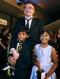 "<p>Director Danny Boyle poses with ""Slumdog Millionaire"" actors Azharuddin Mohammed Ismail (L) and Rubina Ali at the Governors Ball during the 81st Academy Awards in Hollywood, California February 22, 2009. REUTERS/Lucas Jackson</p>"