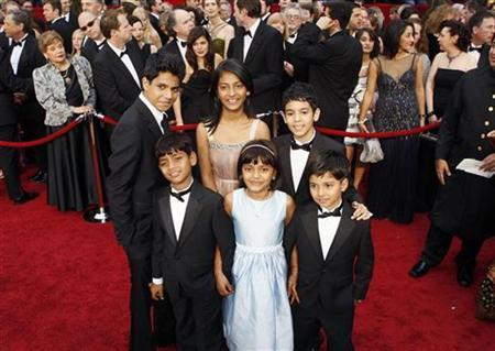 Young actors from ''Slumdog Millionaire'' (front row L-R) Azharuddin Mohammed Ismail, Rubina Ali, Ayush Manesh Khedekar, (back row L-R) Ashotosh Lobo Gajiwala, Tangi Ganesh Lonkar and Tanay Hermant Chheda arrive at the 81st Academy Awards in Hollywood, California February 22, 2009. REUTERS/Lucas Jackson