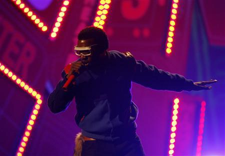 Kanye West performs at the 2008 American Music Awards in Los Angeles in this November 23, 2008 file photo. REUTERS/Mario Anzuoni/Files