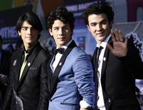 "<p>Cast members (from L-R) Joe Jonas, Nick Jonas and Kevin Jonas attend the premiere of ""Jonas Brothers: The 3D Concert Experience"" at El Capitan theatre in Hollywood, California February 24, 2009. REUTERS/Mario Anzuoni</p>"