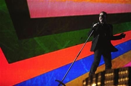 Bono from U2 performs at the Brit Awards at Earls Court in London February 18, 2009. REUTERS/Dylan Martinez