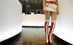 "<p>A stock trader dressed as ""sex nurse Betty"" stands in front of the German share price index DAX board at the German stock exchange in Frankfurt, February 24, 2009. REUTERS/Kai Pfaffenbach</p>"