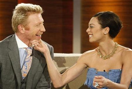 Former German tennis player Boris Becker (L) and Lilly Kerssenberg attend the television show ''Wetten Dass..?'' (Bet it..?) in the western German city of Duesseldorf February 28, 2009. REUTERS/Ina Fassbender
