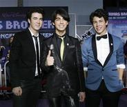 "<p>Kevin Jonas, Joe Jonas e Nick Jonas na premiére de ""Jonas Brothers: The 3D Concert Experience"", no cinema El Capitan, em Hollywood. REUTERS/Mario Anzuoni (EUA)</p>"