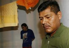 <p>Bolivian street vendor Bigmar Arancibia (R) gives an interview inside a jail in the city of Corumba on the border with Bolivia January 14, 2009. REUTERS/Jamil Bittar</p>