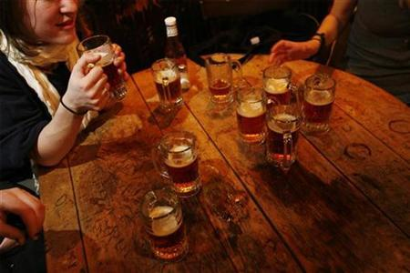 A round of beers sit on a table inside a pub in New York March 11, 2008. REUTERS/Lucas Jackson