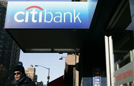 A customer walks out of a Citibank outlet in New York March 4, 2009. REUTERS/Lucas Jackson