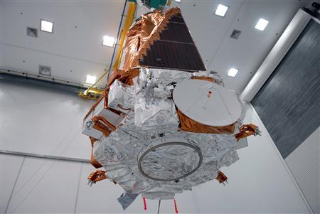 At the Hazardous Processing Facility at Astrotech in Titusville, the suspended Kepler spacecraft is moved toward a Delta II third stage February 16, 2009. REUTERS/NASA/Handout