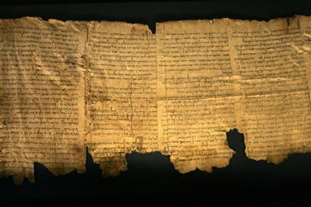 Sections of the ancient Dead Sea scrolls are seen on display at the Israel Museum in Jerusalem May 14, 2008. REUTERS/Baz Ratner
