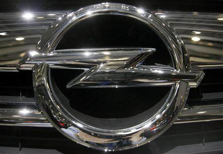 The logo of Opel is shown on the radiator grill of Insignia car during the second media day of the 79th Geneva Car Show at the Palexpo in Geneva March 4, 2009. REUTERS/Arnd Wiegmann