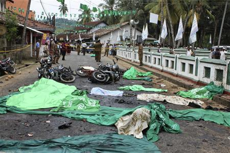 The covered bodies of those killed by a bomb blast are seen outside a mosque in Godapitiya in Matara district, about 160 km (99 miles) south of the capital Colombo, March 10, 2009. REUTERS/Stringer
