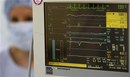 A surgery nurse is seen beside the heart beat monitor February 29, 2008. REUTERS/Fabrizio Bensch
