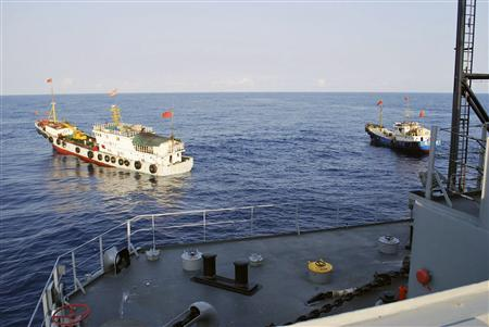Two Chinese trawlers stop directly in front of the military Sealift Command ocean surveillance ship USNS Impeccable (T-AGOS-23) in the South China Sea, in this picture taken March 8, 2009 and released March 9, 2009. REUTERS/U.S. Navy/Handout