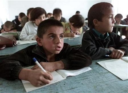 Tajik children sit during the school lesson in the village Surhak Chashma some 35 km from Dushanbe, October 23, 2001. REUTERS/Alexander Demianchuk