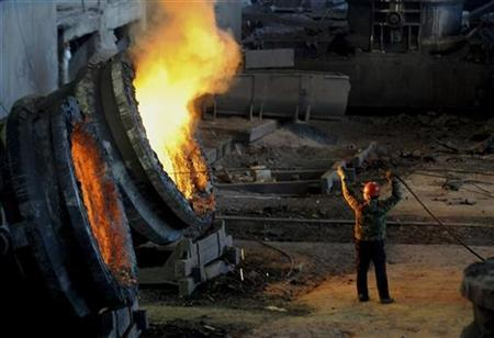 An employee works at the Ma'anshan Iron and Steel Company in Hefei, Anhui province March 6, 2009. REUTERS/Jianan Yu