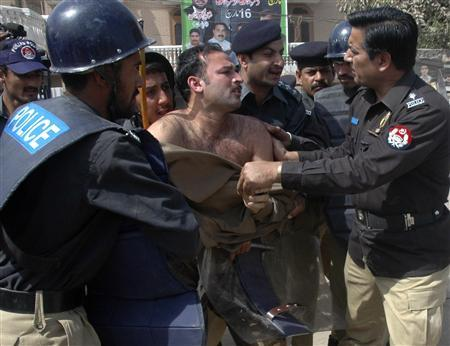Pakistani policemen arrest an activist of the Pakistan Muslim League after government-banned protests in Multan March 11, 2009. REUTERS/Stringer